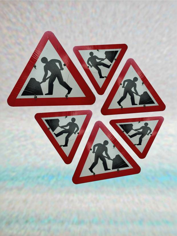 Road Signs Showing Men Working